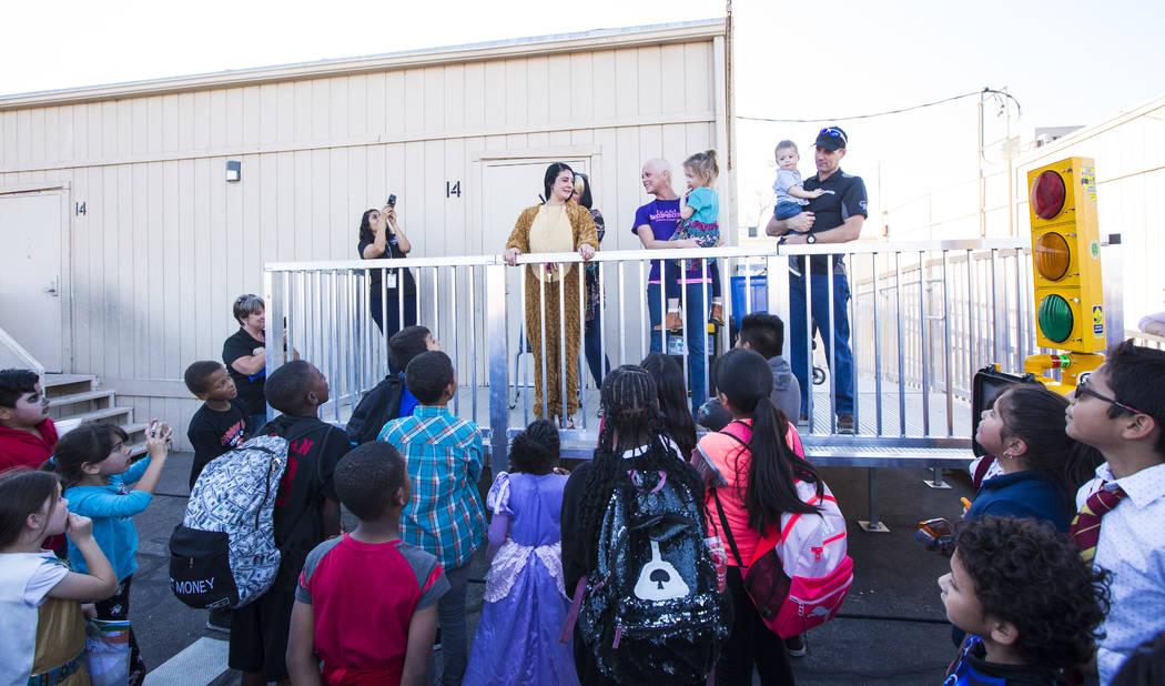 Ronnow Elementary School Principal Michelee Crawford, center left, speaks alongside Jessica Hop ...