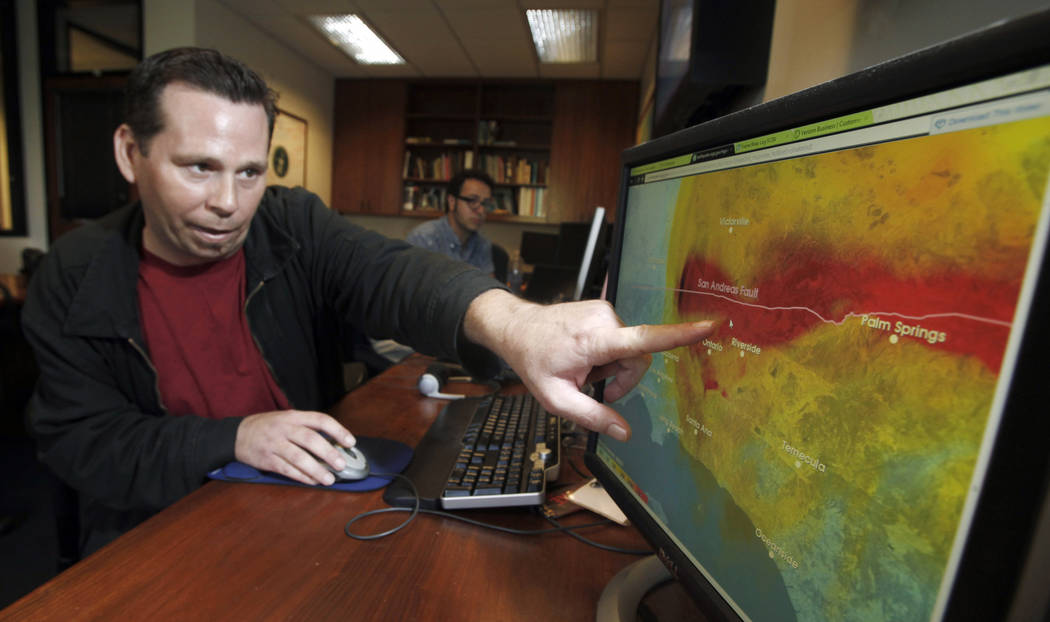 This Sept. 13, 2011 photo shows Anthony Guarino Jr., a seismic analyst at the California Instit ...