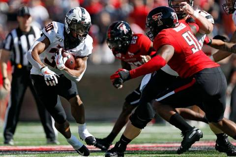 Oklahoma State's Chuba Hubbard (30) runs with the ball during the first half of the NCAA colleg ...