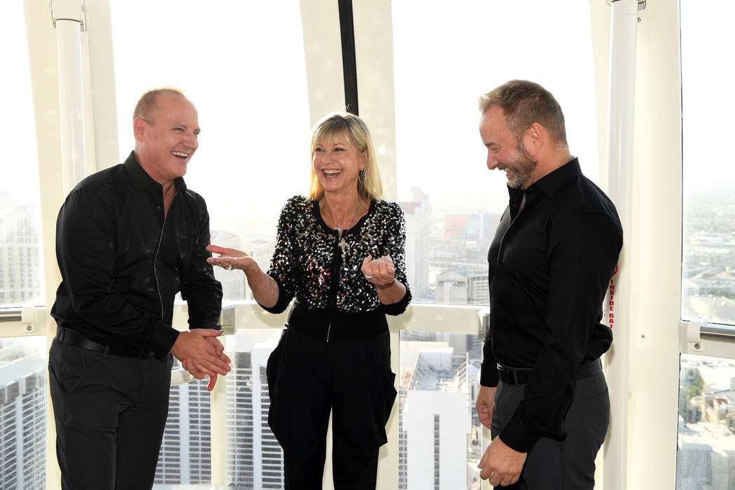 Michael Caprio and Randy Slovacek are shown with Olivia Newton-John at the couple's vow renewal ...