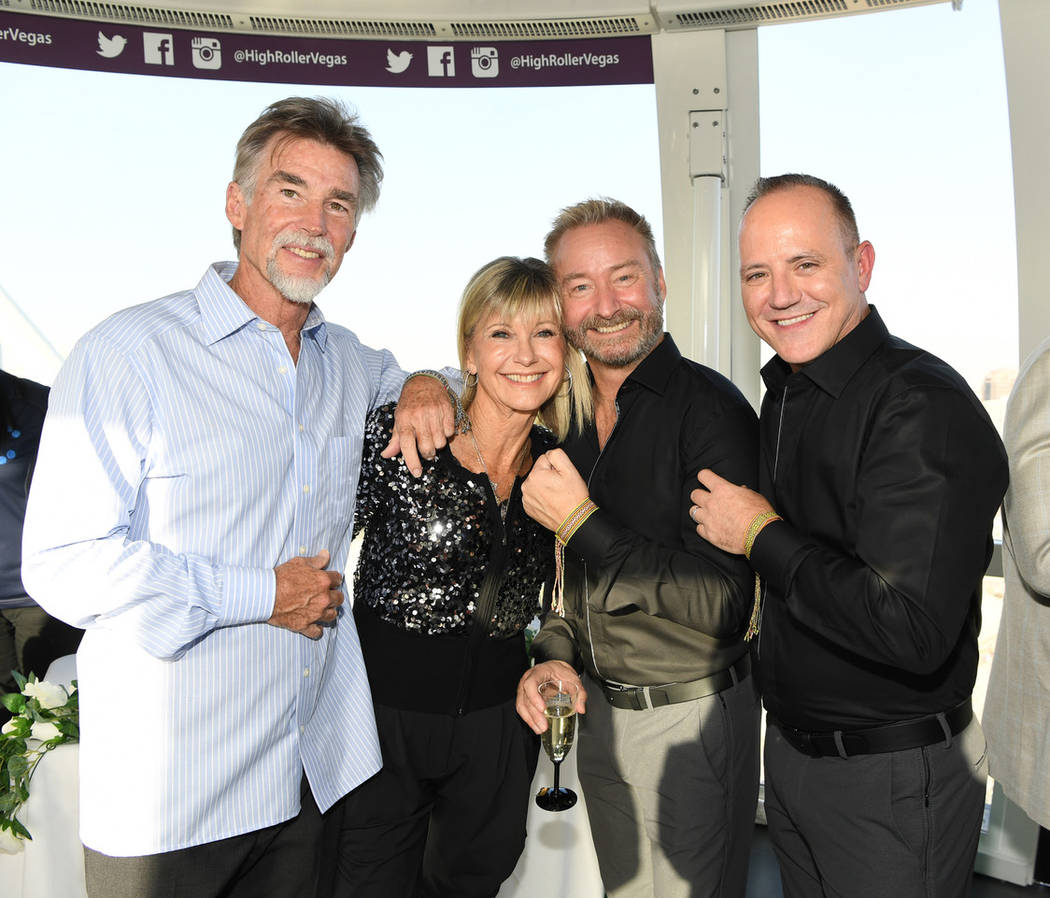 Michael Caprio and Randy Slovacek are shown with Olivia Newton-John and her husband, John Easte ...
