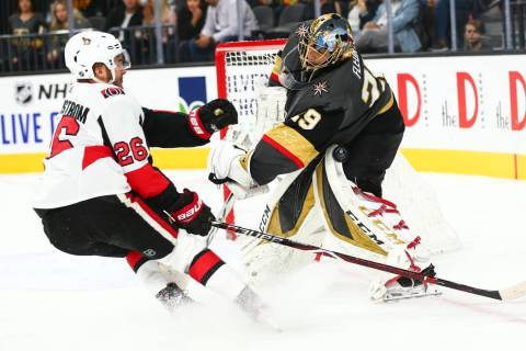 Golden Knights goaltender Marc-Andre Fleury (29) blocks the puck in front of Ottawa Senators' E ...
