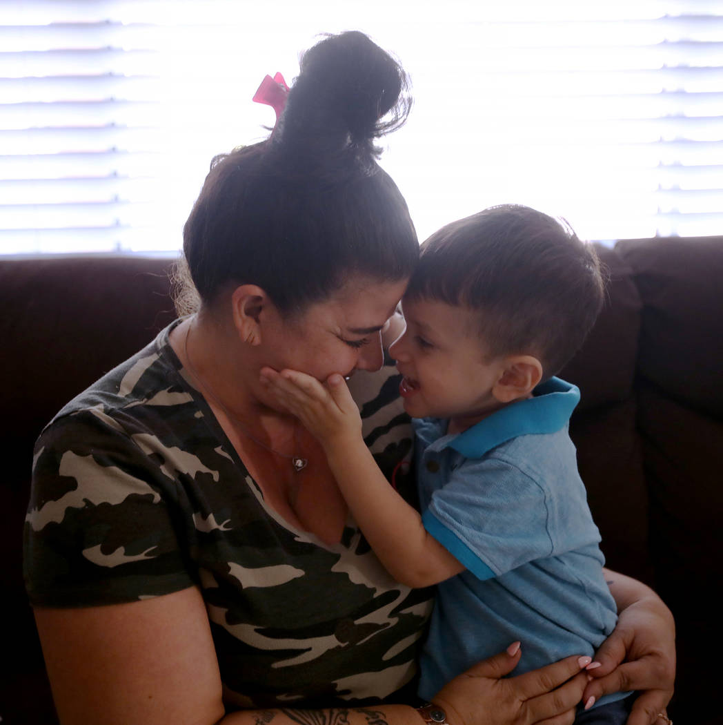 Hanna Olivas cuddles with her grandchild Dominic Camacho, 2, at her home in Las Vegas, Wednesda ...