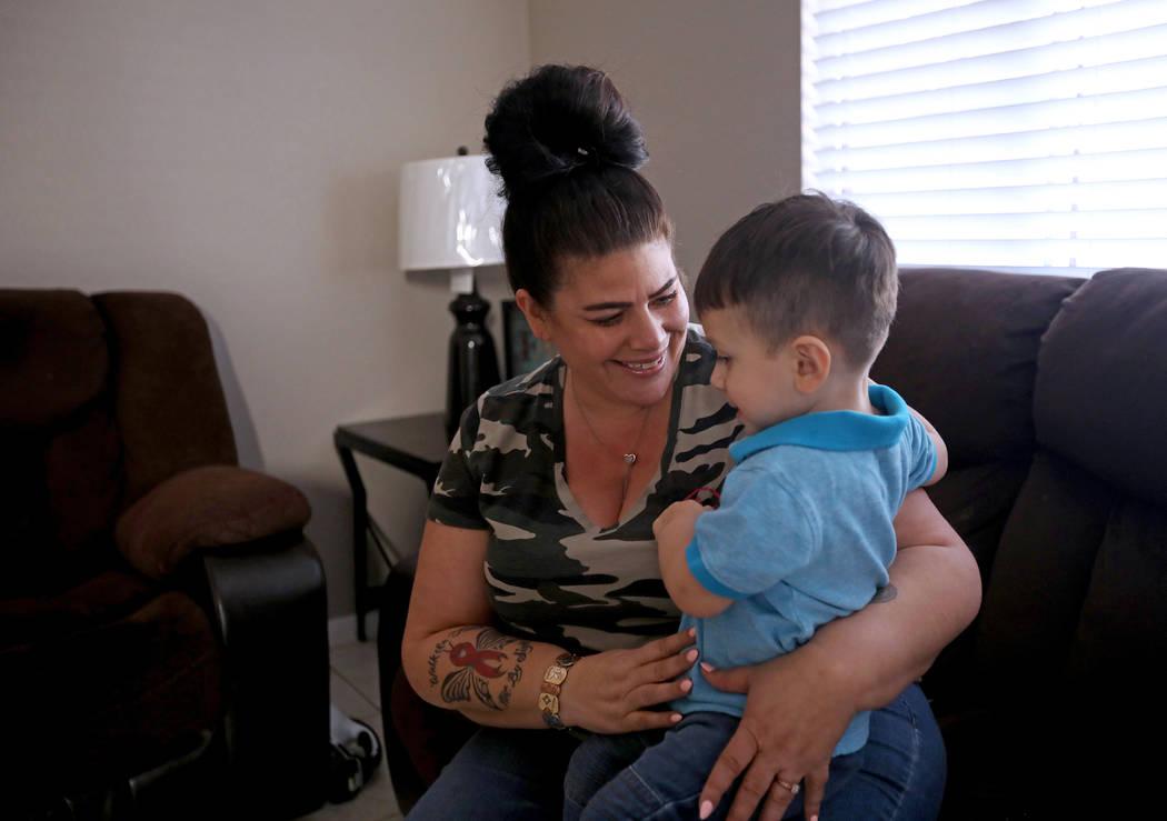 Hanna Olivas cuddles with her grandchild Dominic Camacho, 2, at her home in Las Vegas, Wednesda ...