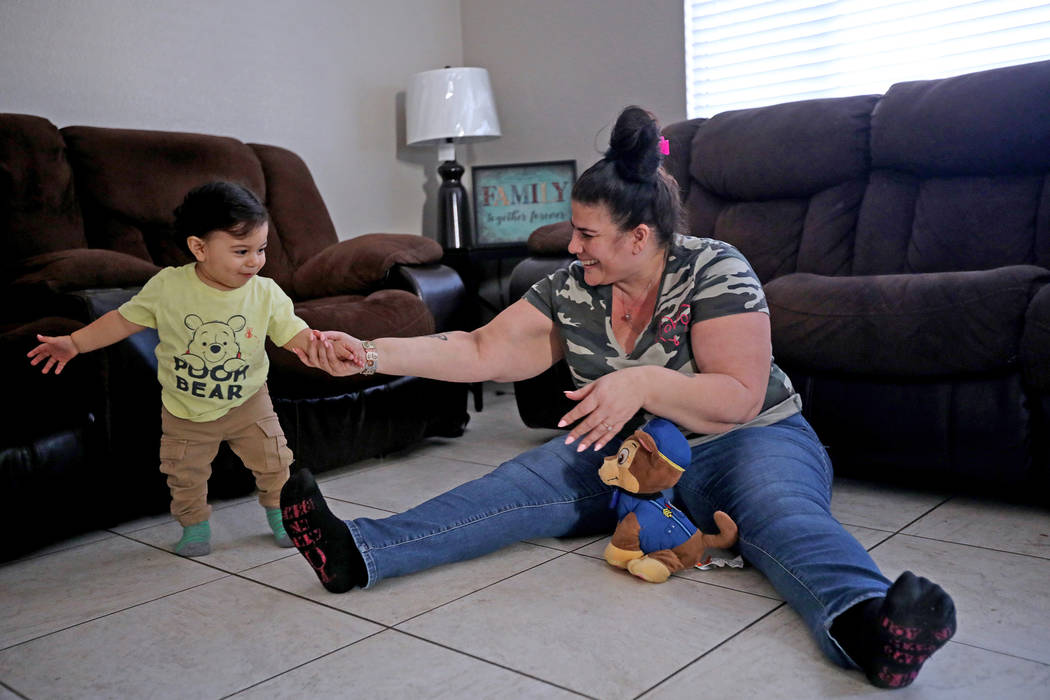 Hanna Olivas plays with her grandchild Damian Cordova, 1, at her home in Las Vegas, Wednesday, ...