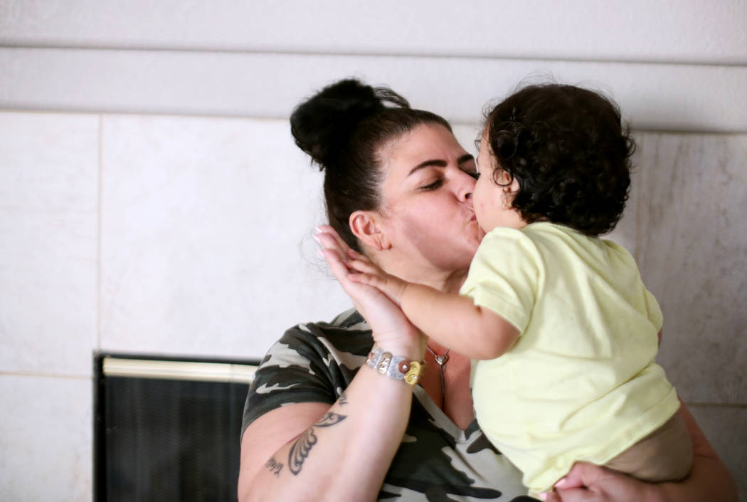 Hanna Olivas kisses her grandchild Damian Cordova, 1, at her home in Las Vegas, Wednesday, Oct. ...