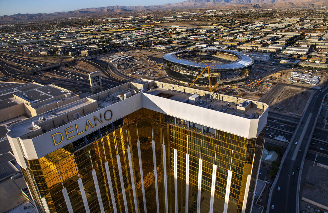 The Delano, near, and the Raiders Allegiant Stadium construction site, above, on Wednesday, Oct ...