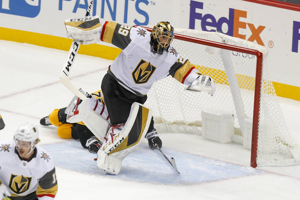 Vegas Golden Knights goaltender Marc-Andre Fleury (29) twists out of the way as Pittsburgh Peng ...