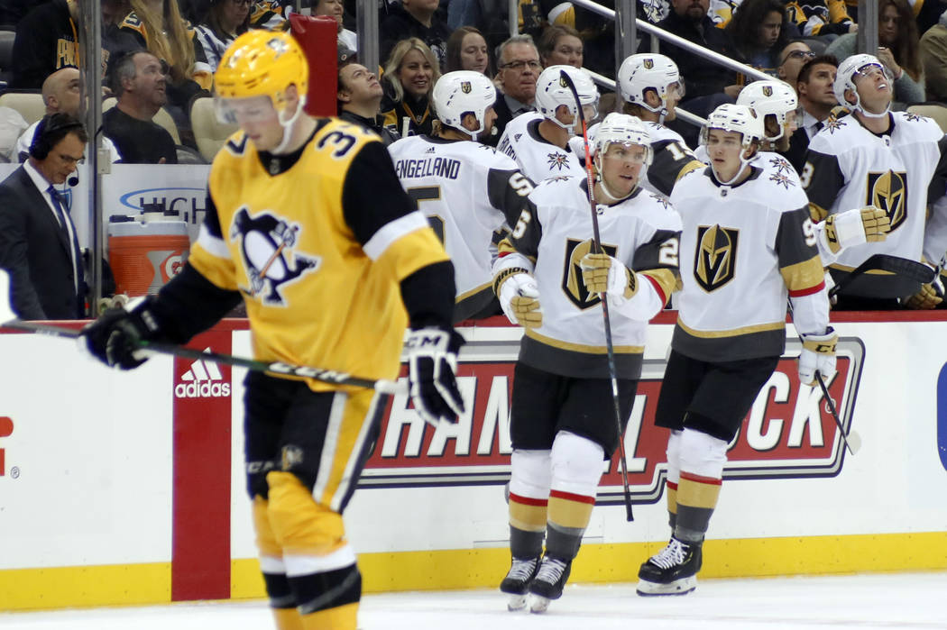 Vegas Golden Knights' Paul Stastny, center, celebrates after scoring as Pittsburgh Penguins' Sa ...