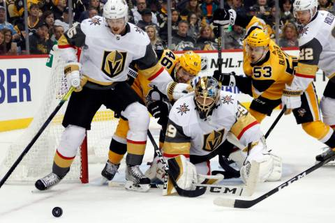 Vegas Golden Knights goaltender Marc-Andre Fleury (29), Jon Merrill (15) and Nick Holden (22) s ...