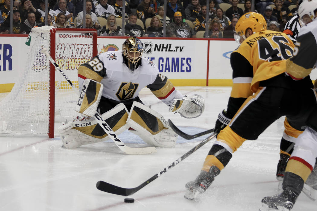 Pittsburgh Penguins' Zach Aston-Reese (46) looks to shoot on Vegas Golden Knights goaltender Ma ...