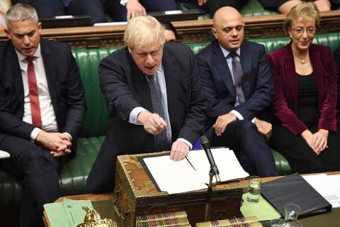 Britain's Prime Minister Boris Johnson speaks to lawmakers inside the House of Commons to updat ...