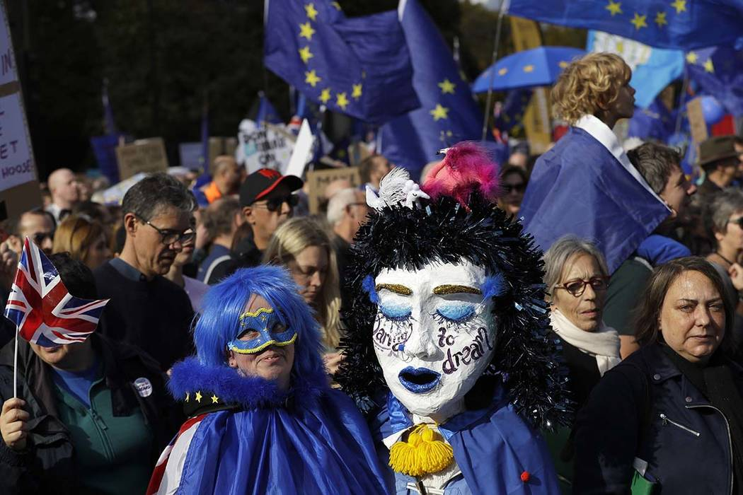 Anti-Brexit protestors march in London, Saturday, Oct. 19, 2019. In their first weekend session ...