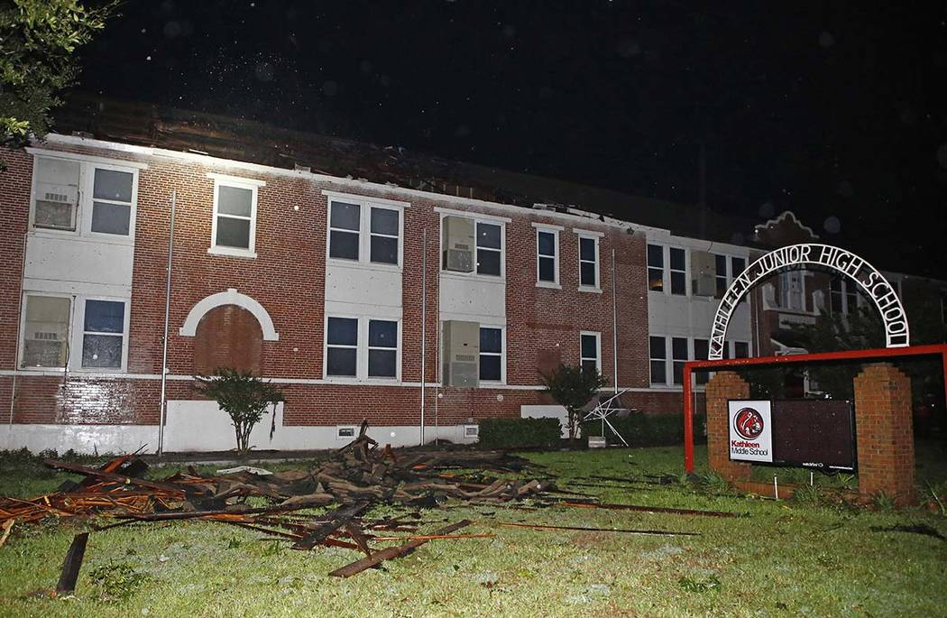 Major damage to the roof of Kathleen Middle School as a tornado ripped across Polk county due t ...