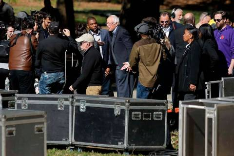 Democratic presidential candidate Sen. Bernie Sanders, I-Vt., (C) arrives to attend a rally on ...