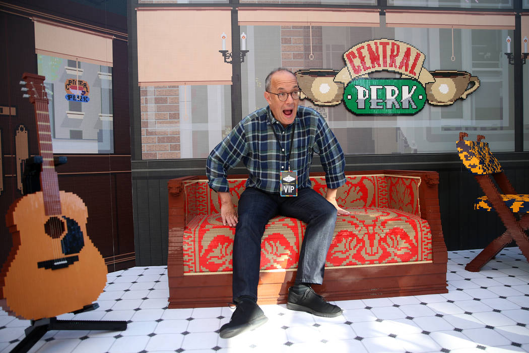 "David Craine, co-creator of the ""Friends"" television show, sits on a Lego couch during the ""F ..."