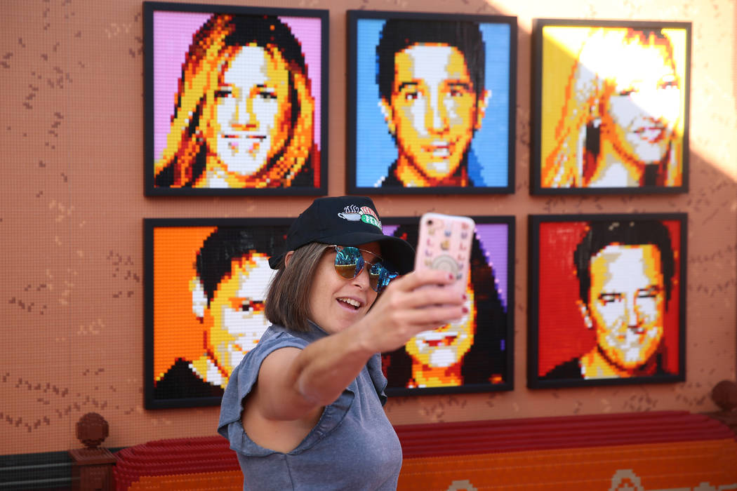 "Lanae Brody, journalist for Hollywood Life, takes a photo inside the ""Friends"" Fan Experien ..."