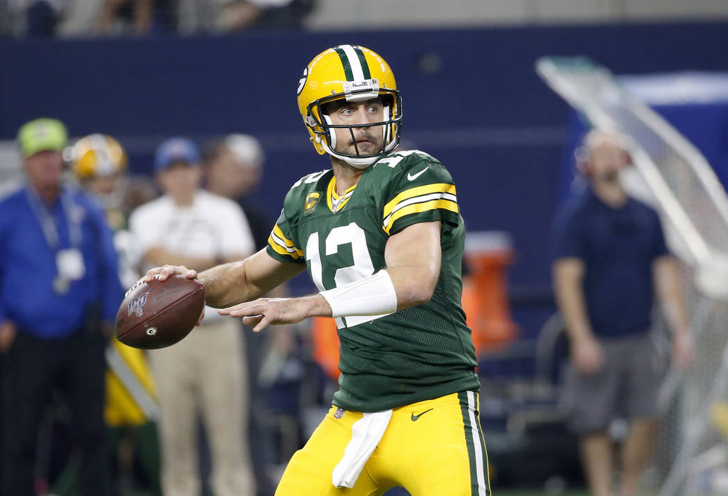 Green Bay Packers quarterback Aaron Rodgers (12) prepares to throw a pass during an NFL footbal ...