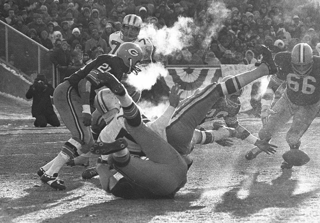 FILE - In this Dec. 31, 1967, file photo, players spill in all directions as a fumble occurs in ...