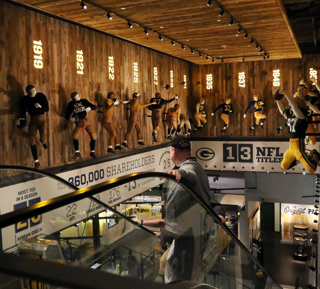 Fans explore Packer history inside the Green Bay Packers Hall of Fame at Lambeau Field in Green ...