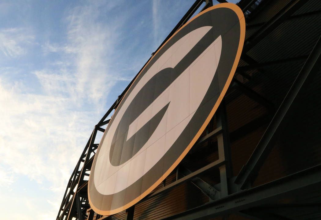 The Green Bay Packers NFL logo at the top of Lambeau Field in Green Bay, Wis., Friday, Oct. 18, ...