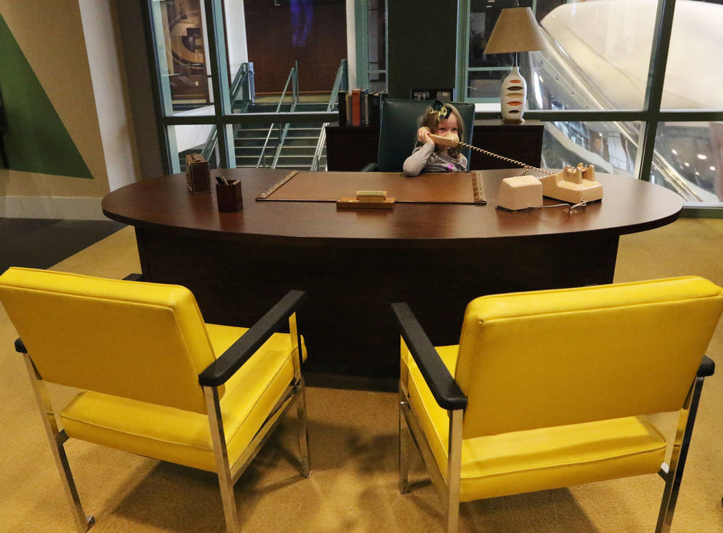 Stella Marti, 5, of Rockville, Md., sits at the former desk of Vince Lombardi, the legendary ex ...