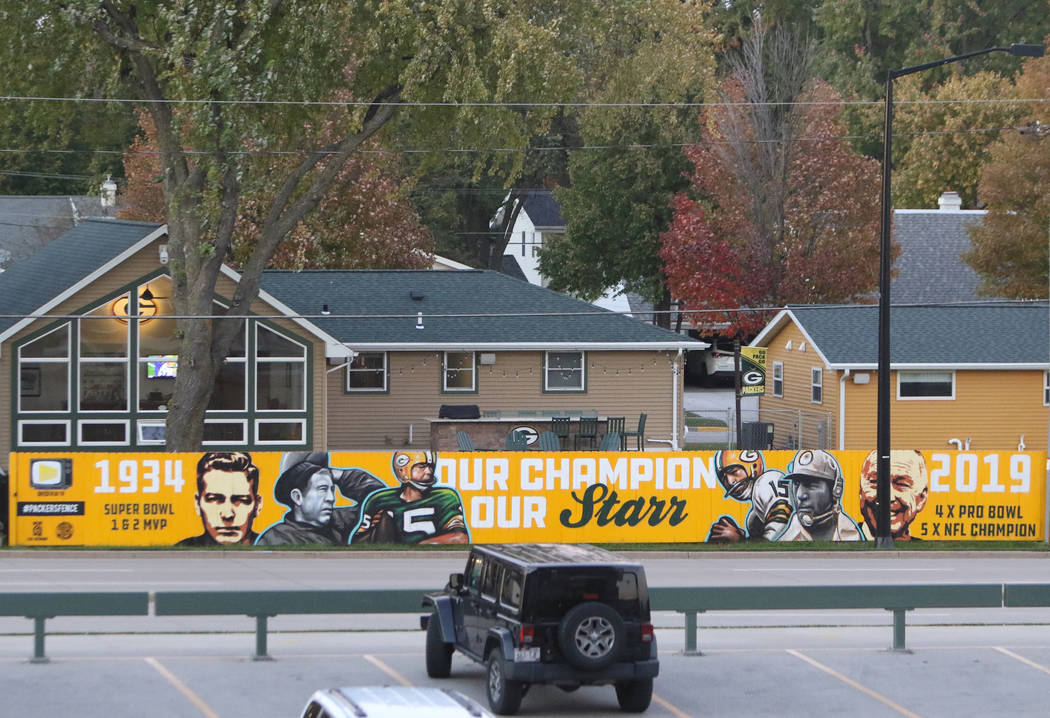 Signage on homes across the street from Lambeau Field in Green Bay, Wis., Friday, Oct. 18, 201 ...