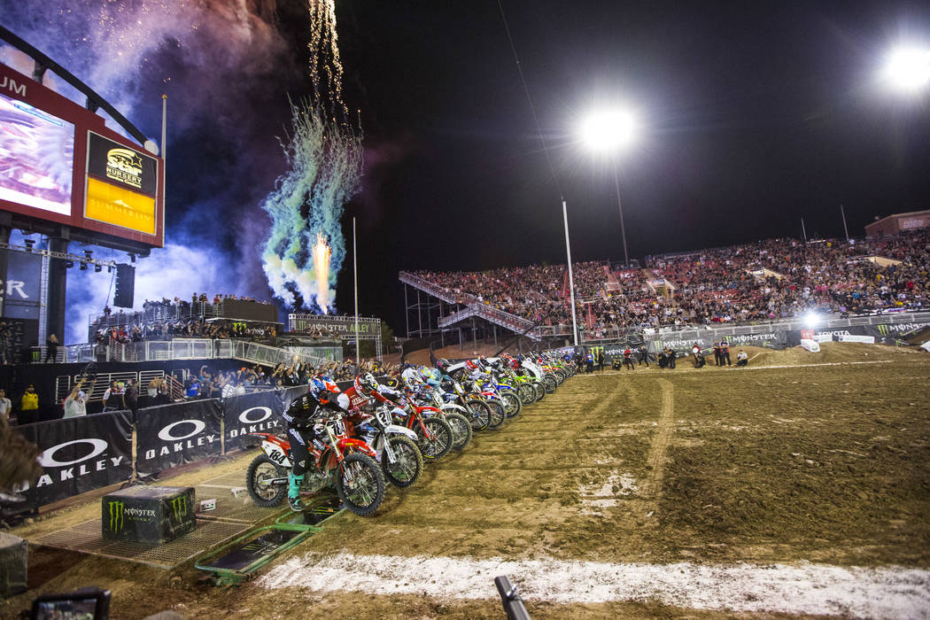 Riders begin the first lap of the first round of the Monster Energy Cup Supercross main event a ...