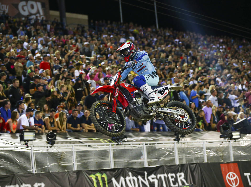 Vince Friese (64) competes during the first round of the Monster Energy Cup Supercross main eve ...