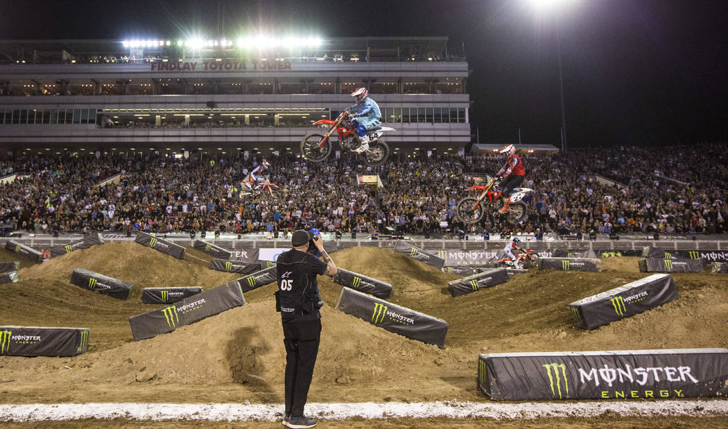 Riders compete during the first round of the Monster Energy Cup Supercross main event at Sam Bo ...