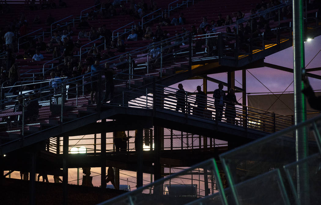Fans are silhouetted as they arrive for the Monster Energy Cup Supercross main event at Sam Boy ...