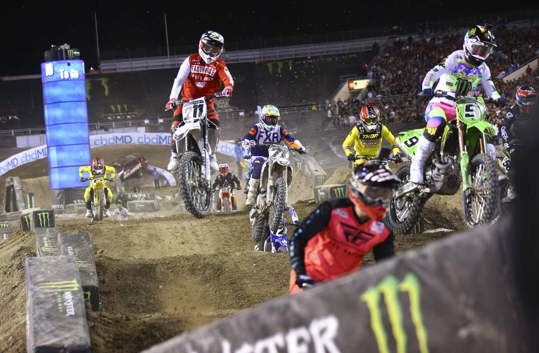 Riders compete during the second round of the Monster Energy Cup Supercross main event at Sam B ...