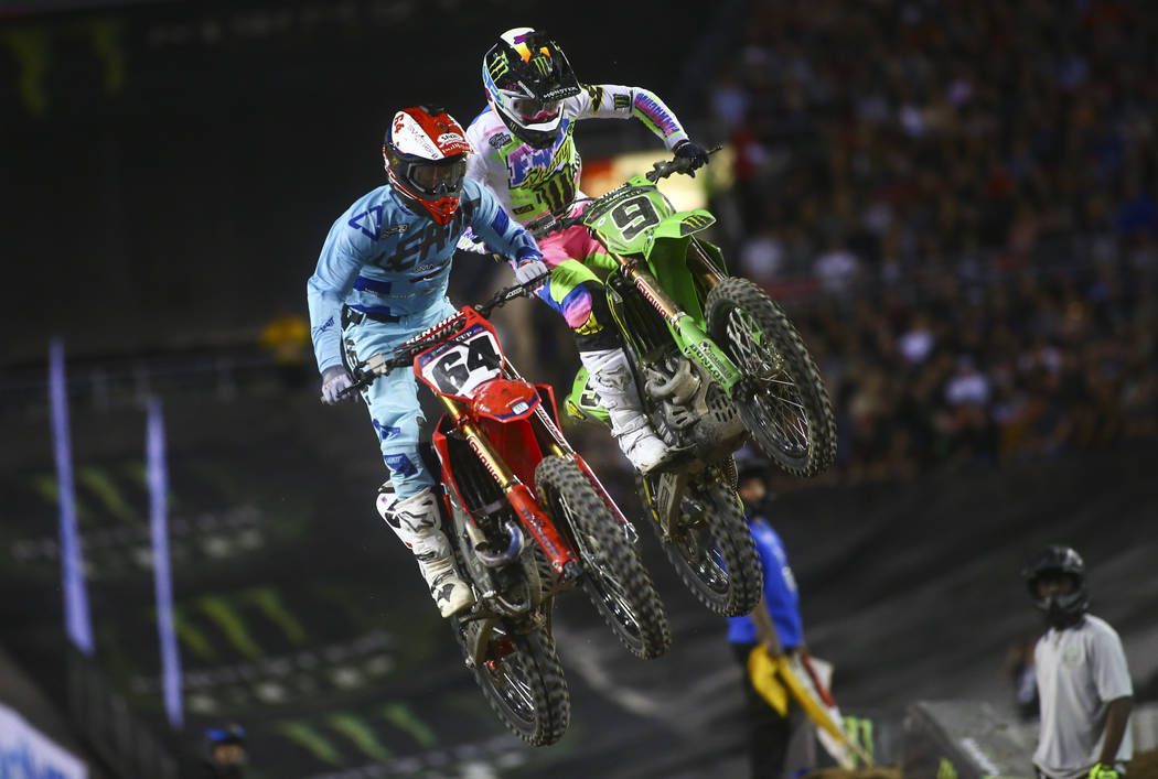 Vince Friese (64) and Adam Cianciarulo (9) compete during the second round of the Monster Energ ...
