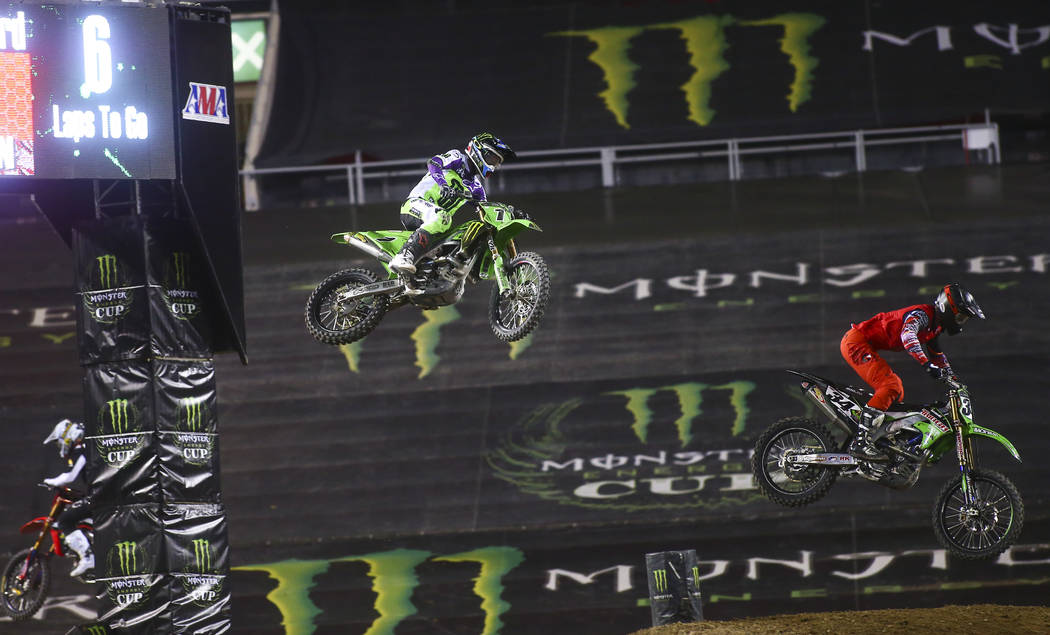 Eli Tomac (1) and Tyler Bowers (34) compete during the second round of the Monster Energy Cup S ...