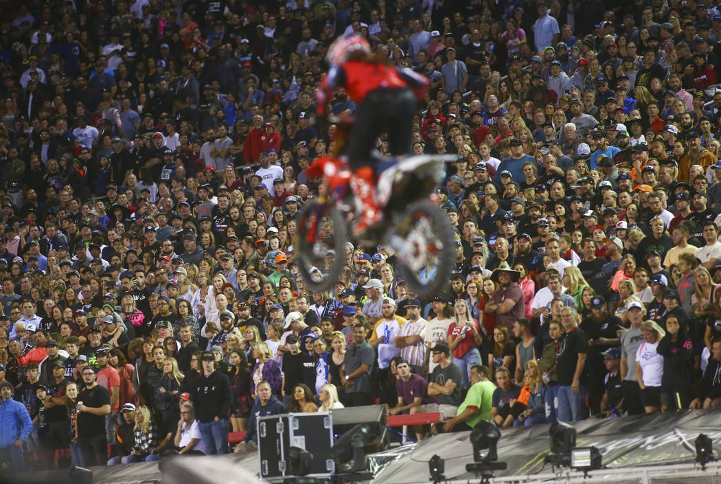 Fans watch as Malcolm Stewart (27) competes during the second round of the Monster Energy Cup S ...