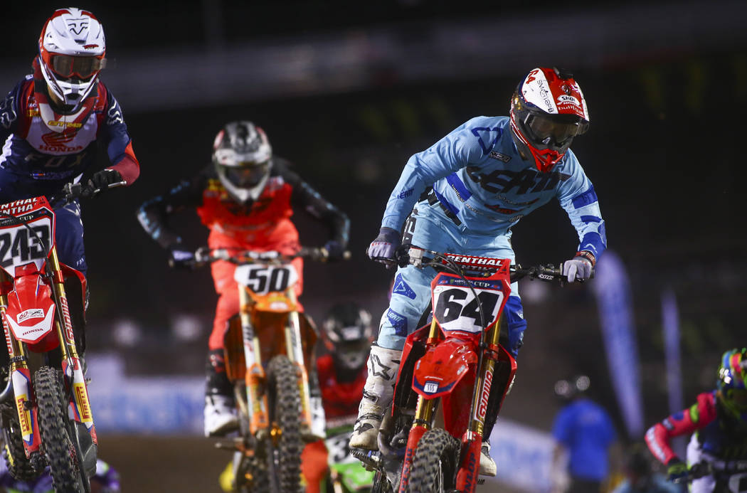 Tim Gajser (243), Benny Bloss (50) and Vince Friese (64) compete during the second round of the ...