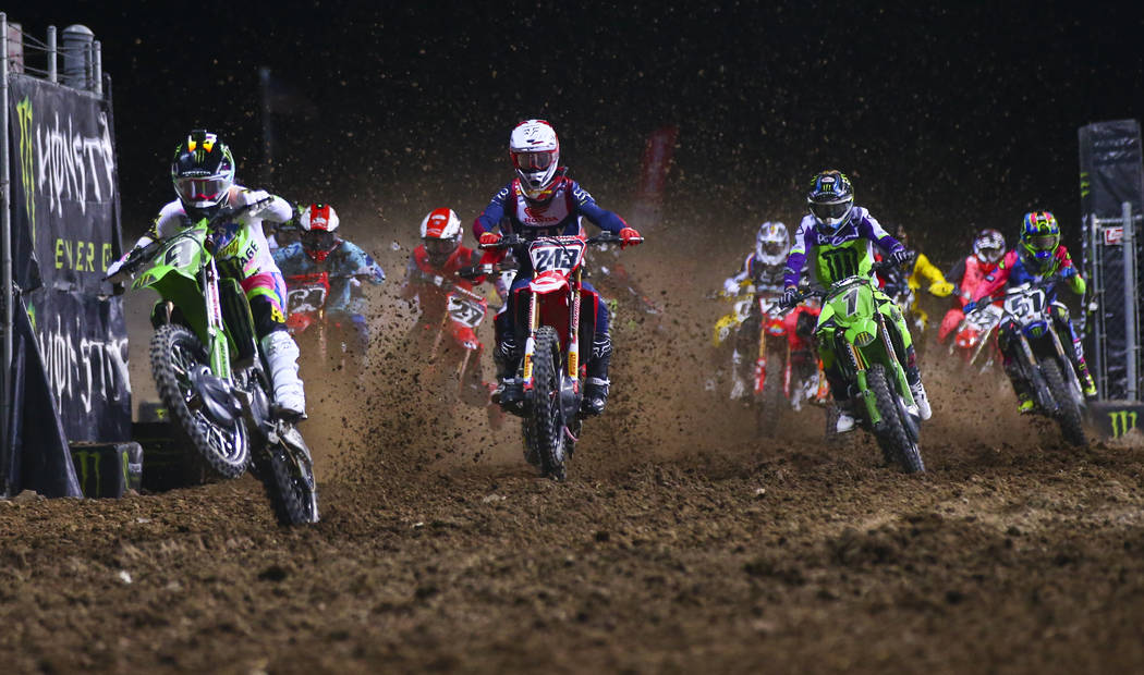 Adam Cianciarulo (9), Tim Gajser (243), and Eli Tomac (1) lead the pack during the third main e ...