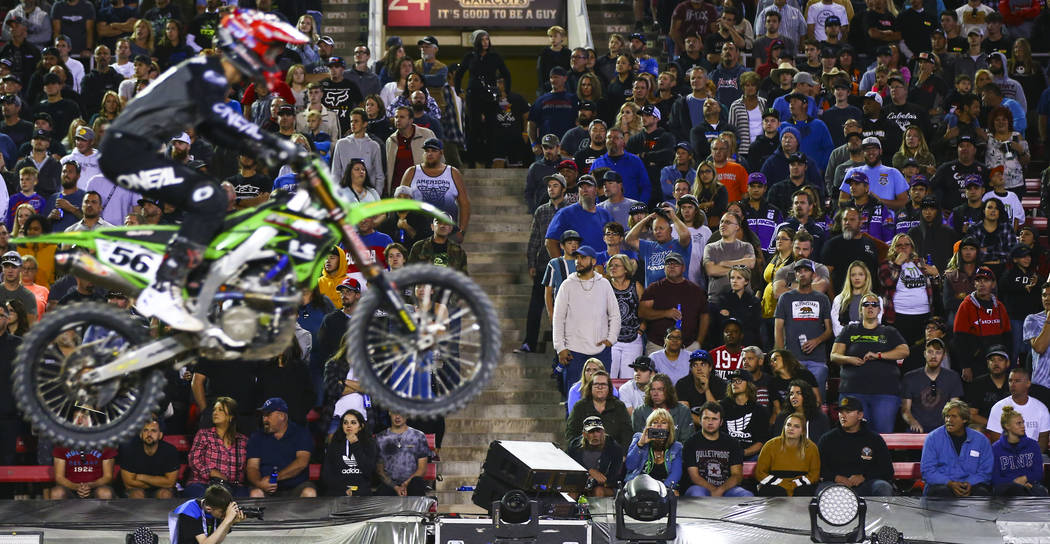 Fans watch Justin Starling (56) pass by during the third main event of the Monster Energy Cup S ...