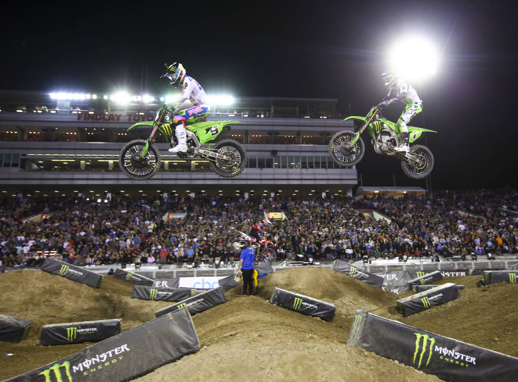 Adam Cianciarulo (9) leads the race past Eli Tomac (1) during the third main event of the Monst ...