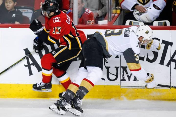 Vegas Golden Knights' Brayden McNabb, right, checks Callgary Flames' Johnny Gaudreau during fir ...