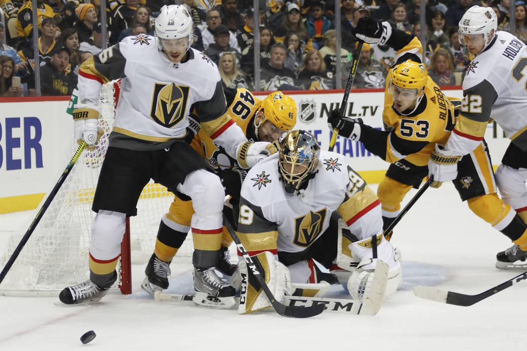Vegas Golden Knights goaltender Marc-Andre Fleury (29), Jon Merrill (15) and Nick Holden (22) s ...