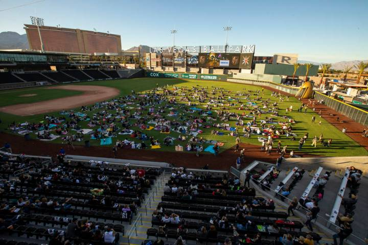 Fans relax on the field and in the stands during the first Vegas Golden Knights watch party as ...