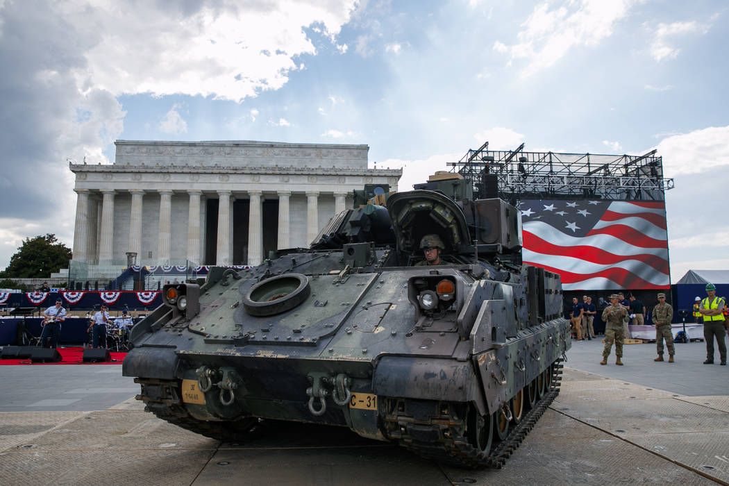 An Army driver with the 3rd Infantry Division, 1st Battalion, 64th Armored Regiment, drives a B ...