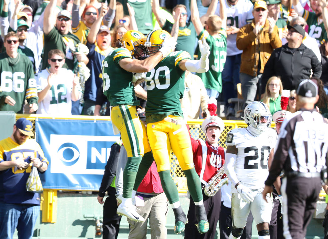 Green Bay Packers wide receiver Jake Kumerow (16) celebrates his touchdown score with Green Bay ...