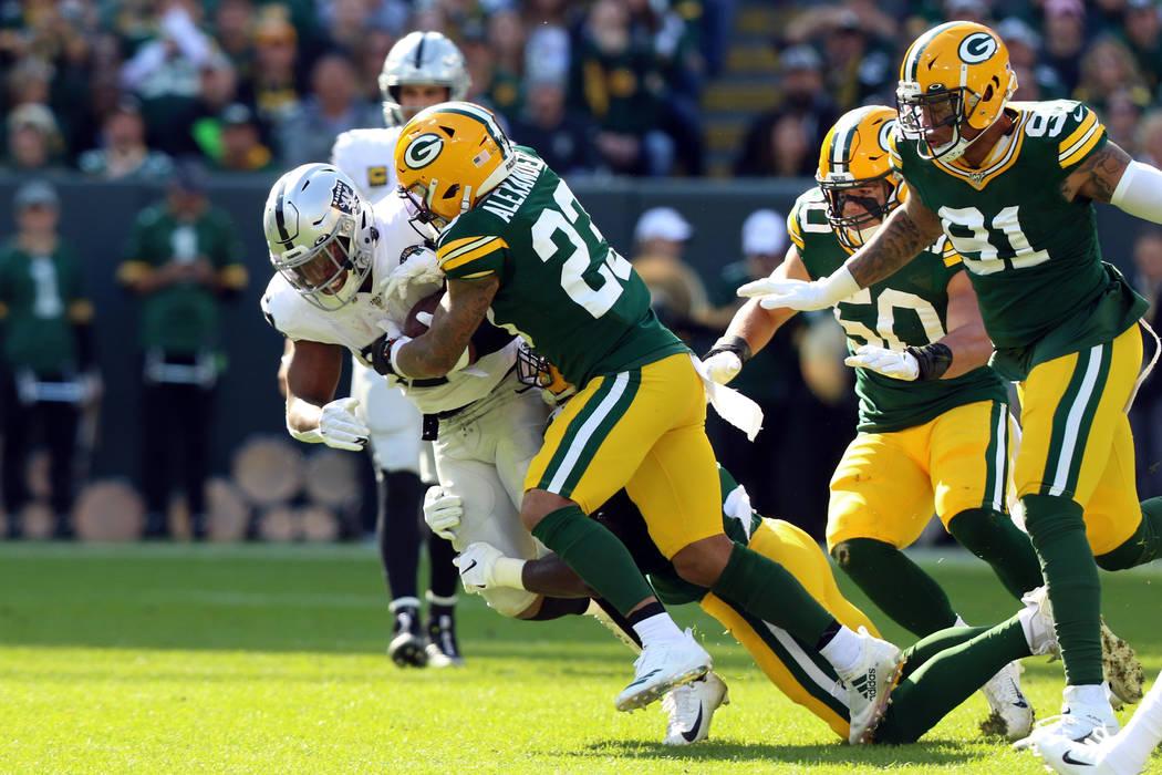 Green Bay Packers cornerback Jaire Alexander (23) tackles Oakland Raiders running back Josh Jac ...