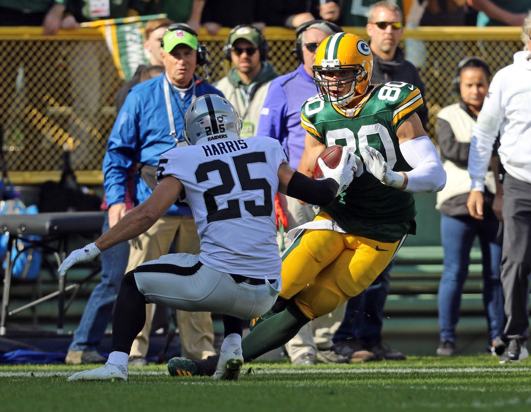 Green Bay Packers tight end Jimmy Graham (80) tries to run past Oakland Raiders free safety Eri ...