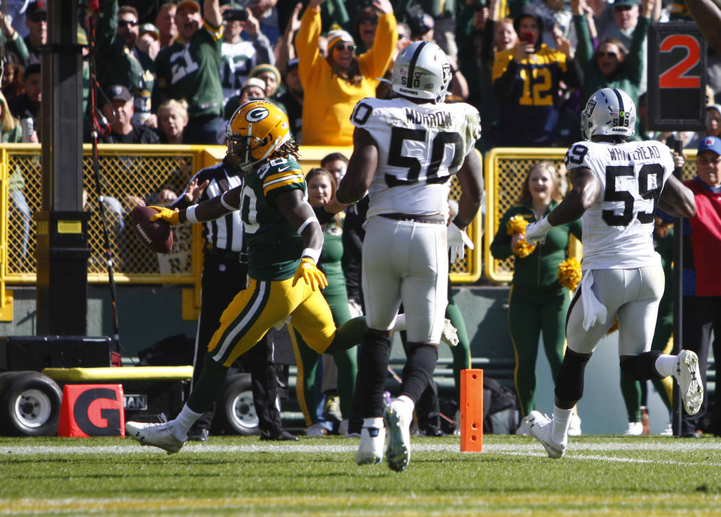 Green Bay Packers running back Jamaal Williams (30) runs in to the end zone as Oakland Raiders ...