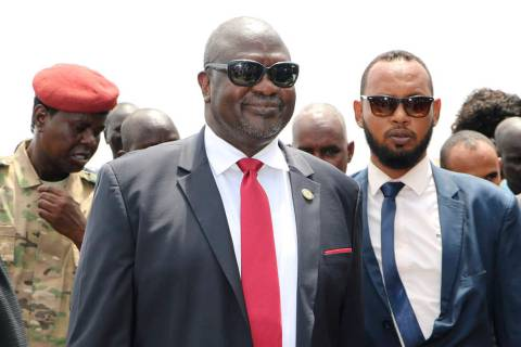 South Sudan opposition leader Riek Machar, centre, as he returns to the country, in Juba, Satur ...
