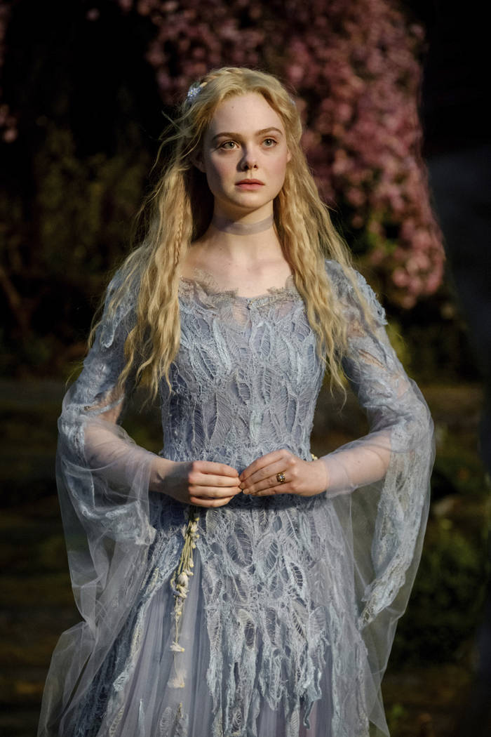 "This image released by Disney shows Elle Fanning as Aurora in a scene from ""Maleficent: Mi ..."