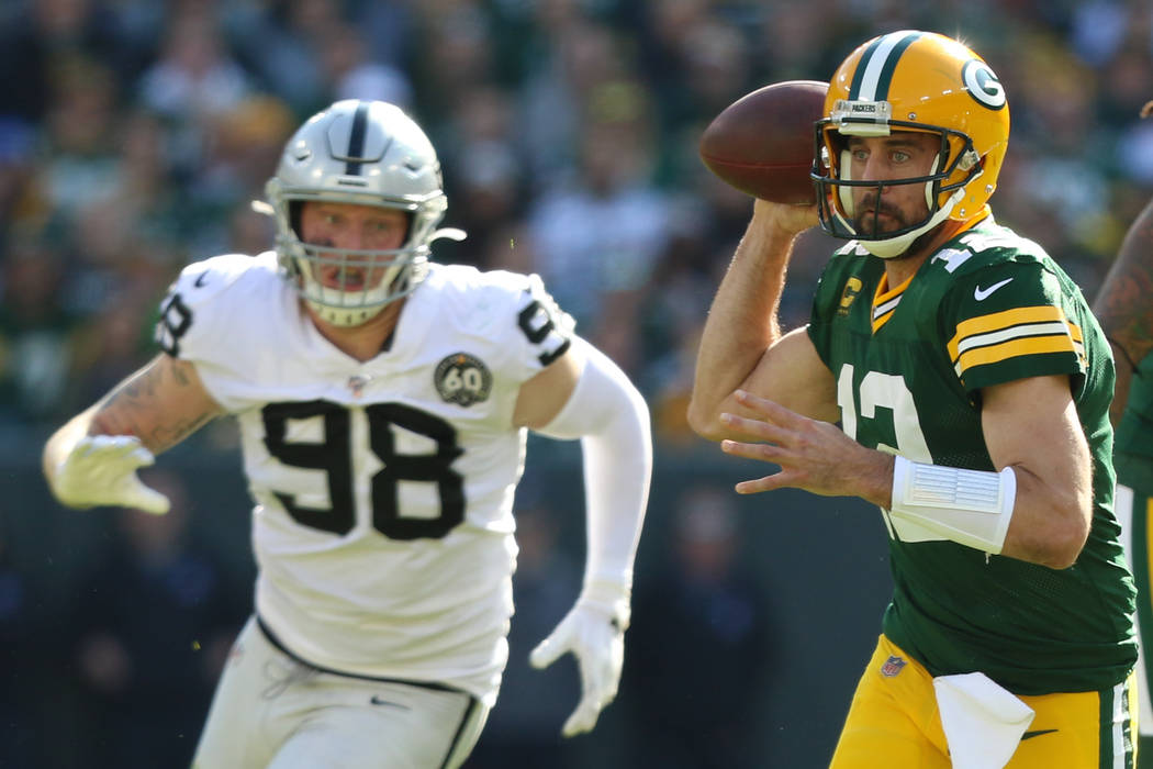 Green Bay Packers quarterback Aaron Rodgers (12) prepares to throw the football as Oakland Raid ...